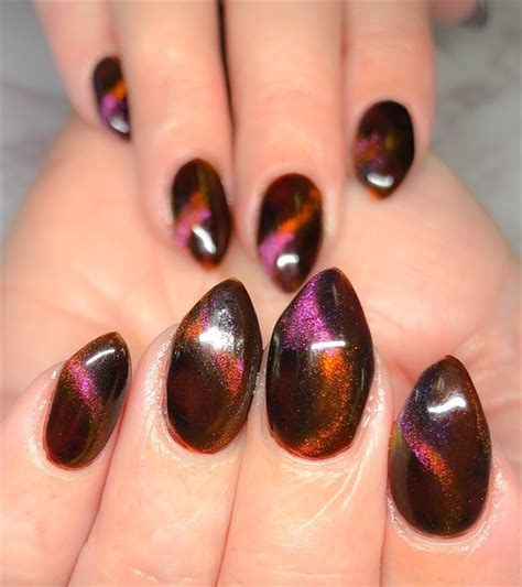 Day 319: Winter Colors and Cat Eye Nail Art - - NAILS Magazine